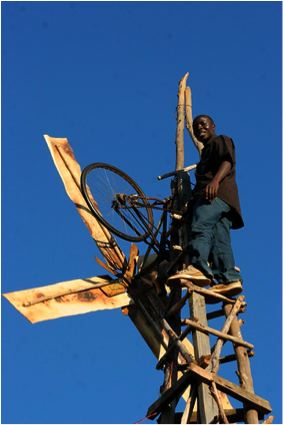 William with the second windmill he contsructed in Malawi
