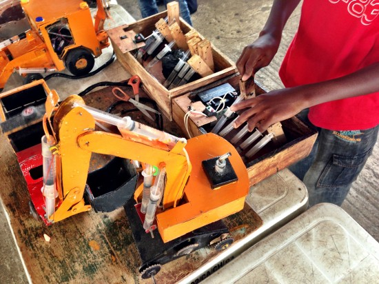 Hydraulic excavator and dumptruck, handmade in Nigeria by a 15 year old boy